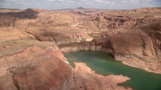AX131_241 - 6K stock footage aerial video of cliffs by Lake Powell, Navajo Canyon, Arizona