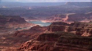 AX132_025 - 6K stock footage aerial video of flying by Lake Powell and mesas, Navajo Nation Reservation, Utah