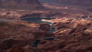 AX132_030 - 6K stock footage aerial video of rock formations and Lake Powell, Navajo Nation Reservation, Utah