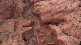 AX132_031 - 6K stock footage aerial video of a bird's eye view of a stone bridge and dry riverbed, Rainbow Bridge National Monument, Utah