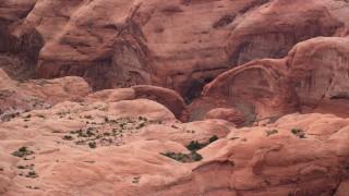 AX132_039 - 6K stock footage aerial video of orbiting a natural stone bridge, Rainbow Bridge National Monument, Utah