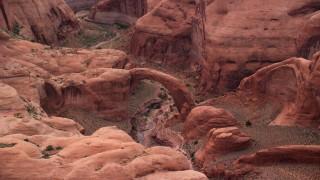 AX132_040 - 6K stock footage aerial video of an orbit of a natural stone bridge, Rainbow Bridge National Monument, Utah