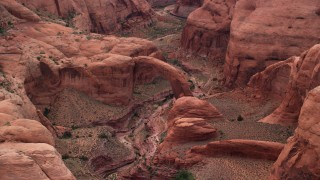 AX132_041 - 6K stock footage aerial video of flying by natural stone arch, Rainbow Bridge National Monument, Utah