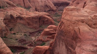 AX132_044 - 6K stock footage aerial video flyby rock formation, reveal stone arch, Rainbow Bridge National Monument, Utah