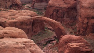 AX132_045 - 6K stock footage aerial video of passing a natural stone arch, Rainbow Bridge National Monument, Utah