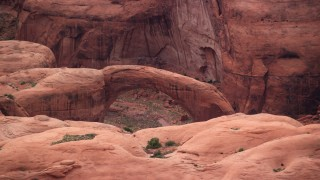 AX132_047 - 6K stock footage aerial video flyby natural stone bridge at Rainbow Bridge National Monument, Utah