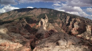 AX132_051 - 6K stock footage aerial video of flying by tall mountain peak, Navajo Mountain, Utah