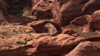 AX132_053 - 6K stock footage aerial video of a stone arch at Rainbow Bridge National Monument, Utah