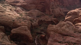 AX132_056 - 6K stock footage aerial video of a view of a stone arch at Rainbow Bridge National Monument, Utah