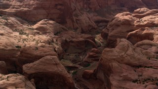 AX132_057 - 6K stock footage aerial video pass a stone arch at Rainbow Bridge National Monument, Utah