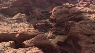 AX132_058 - 6K stock footage aerial video of focusing on a stone arch, Rainbow Bridge National Monument, Utah