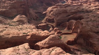 AX132_059 - 6K stock footage aerial video of a stone arch over dry riverbed, Rainbow Bridge National Monument, Utah