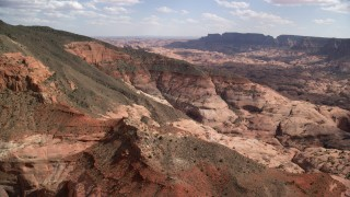 AX132_063 - 6K stock footage aerial video of approaching mountain peaks and slopes, Navajo Mountain, Utah