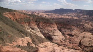 AX132_064 - 6K stock footage aerial video of flying toward mountain peaks and slopes, Navajo Mountain, Utah