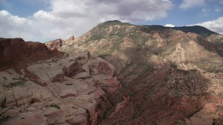AX132_070 - 6K stock footage aerial video of passing by mountain peak slopes, Navajo Mountain, Utah