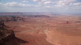 AX132_095 - 6K stock footage aerial video of a view of small buttes and desert valley, Navajo Nation Reservation, Arizona, Utah
