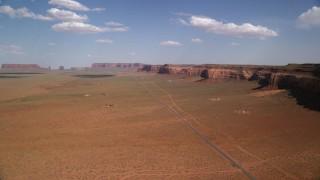 AX132_129 - 6K stock footage aerial video of flying over Oljeto Road near Oljeto Mesa, Navajo Nation Reservation, Arizona, Utah