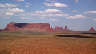 AX132_130 - 6K stock footage aerial video of flying by Eagle Mesa and buttes in Monument Valley, Arizona, Utah