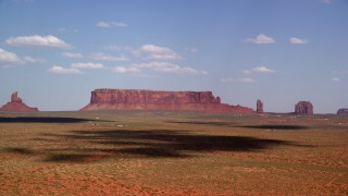 AX132_132 - 6K stock footage aerial video of approaching Sentinel Mesa, nearby buttes, Monument Valley, Arizona, Utah