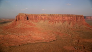 AX133_004 - 6K stock footage aerial video of passing Eagle Mesa in Monument Valley, Utah, Arizona, sunset