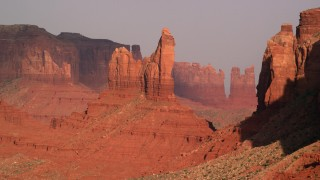 AX133_006 - 6K stock footage aerial video of flying by Setting Hen Butte, Monument Valley, Utah, Arizona, sunset