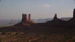 AX133_014 - 6K stock footage aerial video of flying by buttes, desert valley, Monument Valley, Utah, Arizona, sunset