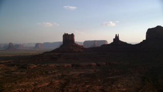 AX133_015 - 6K stock footage aerial video of desert buttes in Monument Valley, Utah, Arizona, sunset