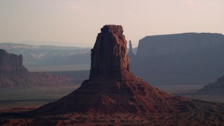 AX133_022 - 6K stock footage aerial video of flying by East Mitten Butte, Monument Valley, Utah, Arizona, twilight