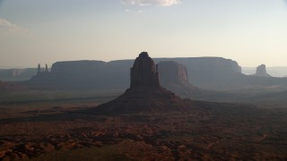 AX133_025 - 6K stock footage aerial video flyby buttes, mesas, desert valley, Monument Valley, Utah, Arizona, twilight