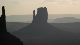 AX133_027 - 6K stock footage aerial video of West Mitten Butte in Monument Valley, Utah, Arizona, twilight