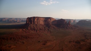 AX133_030 - 6K stock footage aerial video of flying by Spearhead Mesa, Monument Valley, Utah, Arizona, sunset