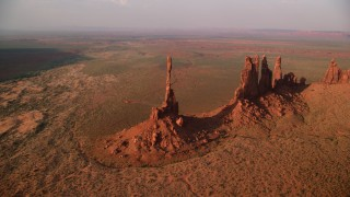 AX133_043 - 6K stock footage aerial video of circling buttes in desert valley, Monument Valley, Utah, Arizona, twilight