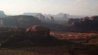 AX133_046 - 6K stock footage aerial video of wide view of buttes and mesas in Monument Valley, Utah, Arizona, twilight