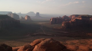 AX133_048 - 6K stock footage aerial video of passing by buttes and mesas in Monument Valley, Utah, Arizona, twilight