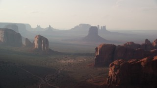 AX133_049 - 6K stock footage aerial video flyby buttes and mesas in Monument Valley, Utah, Arizona, twilight