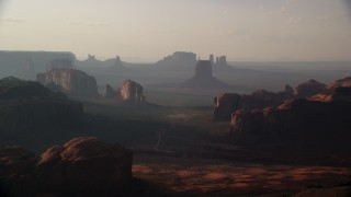 AX133_059 - 6K stock footage aerial video of flying by buttes and mesas in Monument Valley, Utah, Arizona, sunset