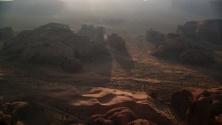 AX133_060 - 6K stock footage aerial video of approaching rock formations, Monument Valley, Utah, Arizona, sunset