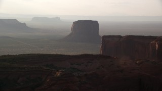 AX133_073 - 6K stock footage aerial video of approaching Mitchell Butte in Monument Valley, Utah, Arizona, twilight