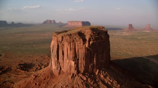AX133_080 - 6K stock footage aerial video of an orbit of Mitchell Butte, Monument Valley, Utah, Arizona, sunset