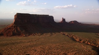 AX133_088 - 6K stock footage aerial video of flying by Eagle Mesa and Setting Hen Butte, Monument Valley, Utah, Arizona, twilight