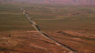 AX133_099 - 6K stock footage aerial video of passing by Highway 163 in Monument Valley, Utah, Arizona, twilight