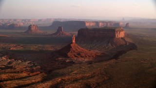 AX133_131 - 6K stock footage aerial video of Big Indian Butte, nearby buttes in Monument Valley, Utah, Arizona, twilight