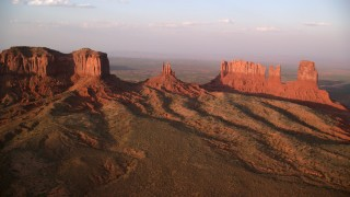 AX133_139 - 6K stock footage aerial video of flying by and approaching buttes in Monument Valley, Utah, Arizona, twilight