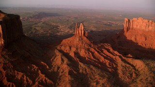 AX133_141 - 6K stock footage aerial video of approaching King on His Throne Butte, Monument Valley, Utah, Arizona, twilight