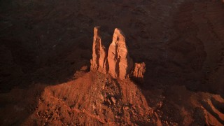 AX133_142 - 6K stock footage aerial video bird's eye view of King on His Throne Butte, Monument Valley, Utah, Arizona, sunset