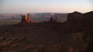 AX133_144 - 6K stock footage aerial video of flying by several buttes in Monument Valley, Utah, Arizona, twilight