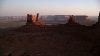 AX133_146 - 6K stock footage aerial video of passing by several buttes in Monument Valley, Utah, Arizona, sunset