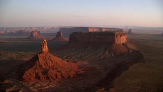AX133_154 - 6K stock footage aerial video of passing buttes and mesas in famous Monument Valley, Utah, Arizona, sunset