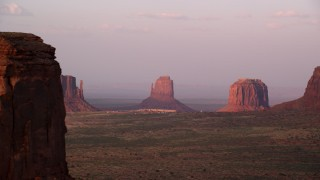 AX133_171 - 6K stock footage aerial video of buttes and The View Hotel in Monument Valley, Utah, Arizona, sunset