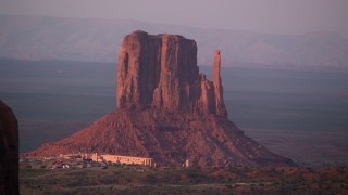 AX133_174 - 6K stock footage aerial video of buttes, mesa and The View Hotel, Monument Valley, Utah, Arizona, sunset